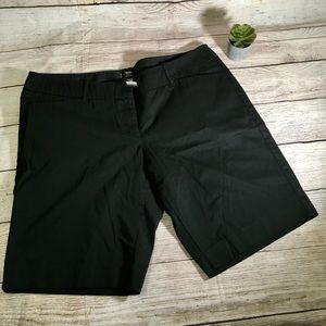 Black Bermuda shorts.